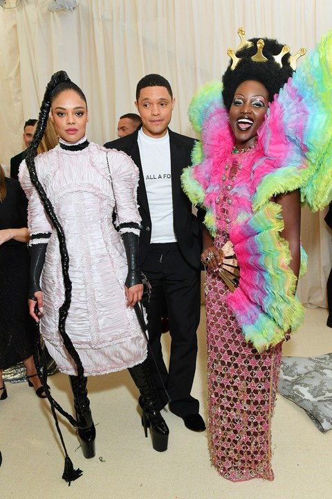 Tessa Thompson, Trevor Noah, and Lupita Nyong'o (in Versace)Tessa Thompson, Trevor Noah, and Lupita Nyong'o (in Versace). Photo by Mike Coppola